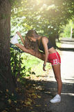 Young beautiful woman stretching royalty free stock images