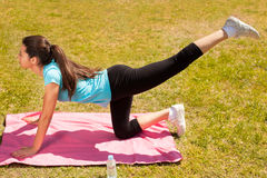 Young beautiful woman stretching after sport stock images