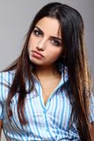 Young and beautiful woman in striped blouse Stock Image