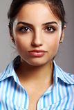 Young and beautiful woman in striped blouse Royalty Free Stock Photos