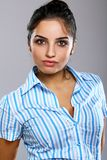 Young and beautiful woman in striped blouse Royalty Free Stock Image