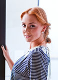 Young beautiful woman in striped blouse Stock Photos