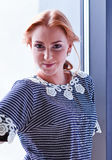 Young beautiful woman in striped blouse Royalty Free Stock Photos