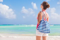 Young beautiful woman with stripy bag at sunny Royalty Free Stock Photo