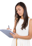 Young, beautiful woman/student or businessperson writing serious notes Stock Image