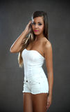 Young beautiful woman. Studio shot of young beautiful woman on dark background Stock Photo