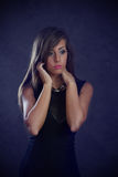 Young beautiful woman. Studio shot of young beautiful woman on dark background Stock Image