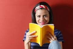 Young beautiful woman studying Royalty Free Stock Photos