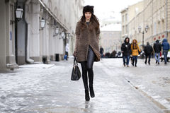 Young beautiful woman in stylish mink coat Stock Images