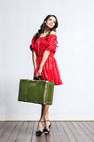 Young and beautiful woman with a suitcase Stock Photography