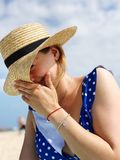 Shy hat at the beach stock photos