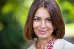 Young beautiful woman in summer park smiling Royalty Free Stock Photos