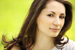 Young beautiful woman in summer park smiling Royalty Free Stock Photo