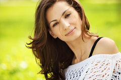 Young beautiful woman in summer park smiling Royalty Free Stock Images