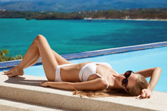Young beautiful woman sunbathing. Nice sea view. Royalty Free Stock Photography