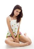 Young beautiful woman in sundress sitting Royalty Free Stock Photo