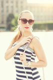 Young beautiful woman with sunglasses in the city Stock Photo