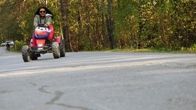 Young beautiful woman in sunglasses driving ATV in slowmotion. 1920x1080 stock footage