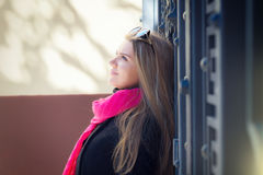 Young beautiful woman in sunglasses. Portrait of a beautiful young woman, long-haired blonde. she wears a black coat, a bright pink scarf. color sunglasses with Royalty Free Stock Photo