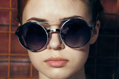 Young beautiful woman in sunglasses on the street, portrait.  Stock Images
