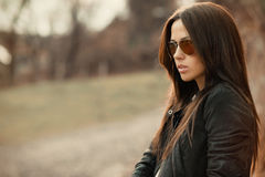 Young beautiful woman in sunglasses at sunset Royalty Free Stock Photography