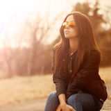 Young beautiful woman in sunglasses at sunset Stock Photography