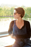 Young beautiful woman in sunglasses at sunset Stock Photo