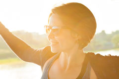 Young beautiful woman in sunglasses at sunset Royalty Free Stock Image