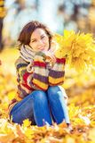 Young beautiful woman in sunny park. Young smiling woman in sunny autumn park Royalty Free Stock Photography