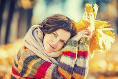 Young beautiful woman in sunny park. Young smiling woman in sunny autumn park Royalty Free Stock Photo