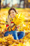 Young beautiful woman in sunny park Stock Images