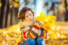 Young beautiful woman in sunny park Royalty Free Stock Photo