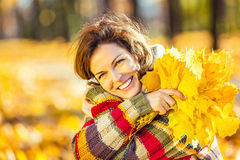 Young beautiful woman in sunny park Royalty Free Stock Photography
