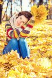 Young beautiful woman in sunny park. Young smiling woman in sunny autumn park Stock Photos