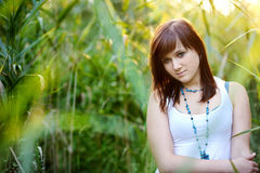 Young beautiful woman at a sunset Stock Images