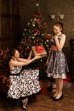 Young beautiful woman surprised and happy to receive present. Woman getting gift. Young beautiful women surprised and happy to receive present Stock Photography
