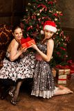 Young beautiful woman surprised and happy to receive present. Woman getting gift. Young beautiful women surprised and happy to receive present Stock Photo