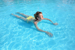 Young beautiful woman swimming in paddling pool Stock Photo