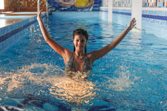 Young beautiful woman in swimming pool Stock Images
