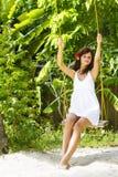Young beautiful woman swinging Stock Image