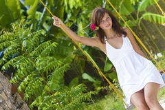 Young beautiful woman swinging Royalty Free Stock Photography