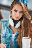 Young beautiful woman at a table in summer cafe Royalty Free Stock Image