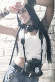 Young beautiful woman taking a photo with a digital camera Stock Photography