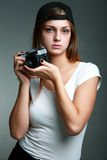Young beautiful woman taking a photo with a retro camera Royalty Free Stock Photos