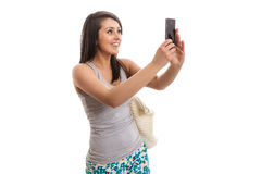 Young beautiful woman taking selfie. Isolated Stock Photography