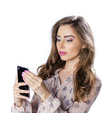 Young beautiful woman taking selfie with mobile phone Royalty Free Stock Image