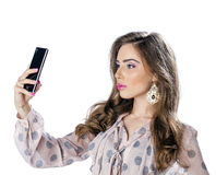 Young beautiful woman taking selfie with mobile phone Royalty Free Stock Images