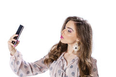Young beautiful woman taking selfie with mobile phone Stock Photo