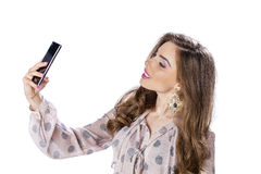 Young beautiful woman taking selfie with mobile phone Stock Photos