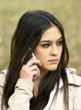 Young beautiful woman talking on cell phone Royalty Free Stock Image